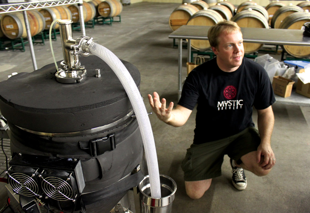Bryan Greenhagen explains the science behind isolating yeast strains in his Chelsea, Mass., brew space.