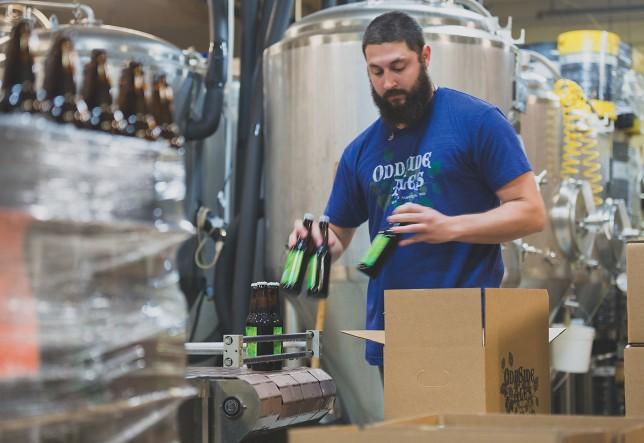 Josh Gordon works on the bottling line at Odd Side Ales. | Photo by Bryan Esler