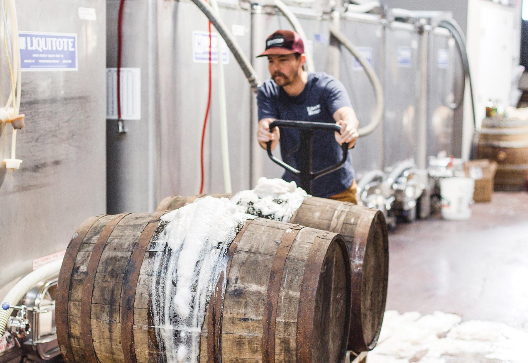 Transporting barrels at Libertine. | Photo by Jacqueline Pilar