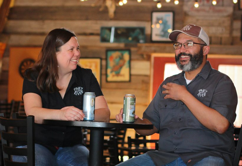 Piney River owners Joleen and Brian Durham enjoy beers in their taproom, the BARn. | Photo by Brooke Hamilton